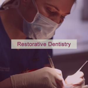 Dentist at OCM working on teeth
