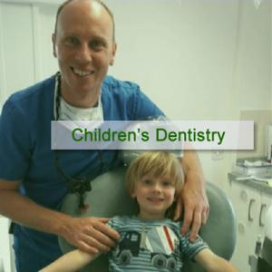 Child sitting in dentist chair at OCM Dental with Gavin
