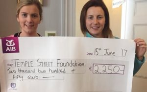 Tanya and her sister with cheque for Temple Street