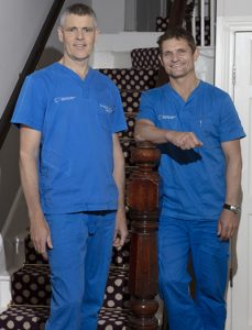 Dentists Steve Moore & Patrick O Connor at stairs of Dental Practice Sligo
